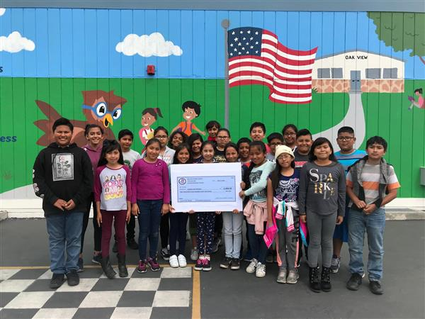 Oak View students with donation check