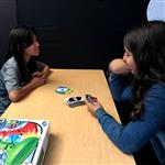 Girls playing Uno in game room
