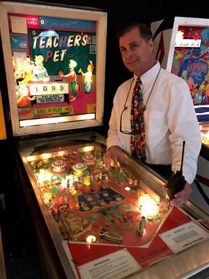 Mr. Cooley with pinball machine