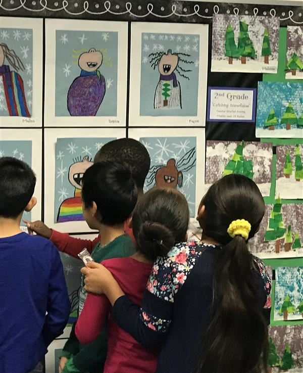 Students view art wall