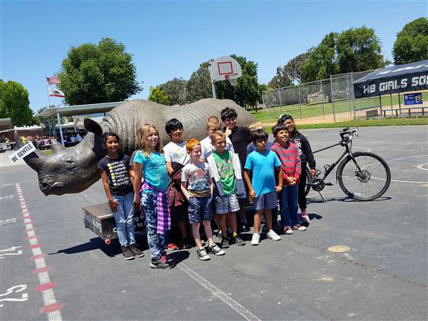 Students with Life Size Rhino
