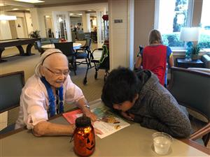 Retiree works with Oak View student