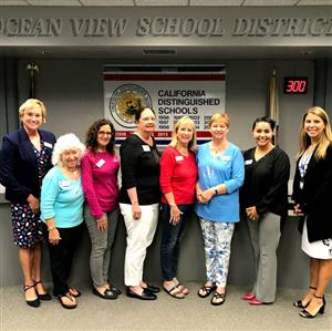 Assistance League HB with OVSD administrators and board member