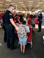 officers helping students in store
