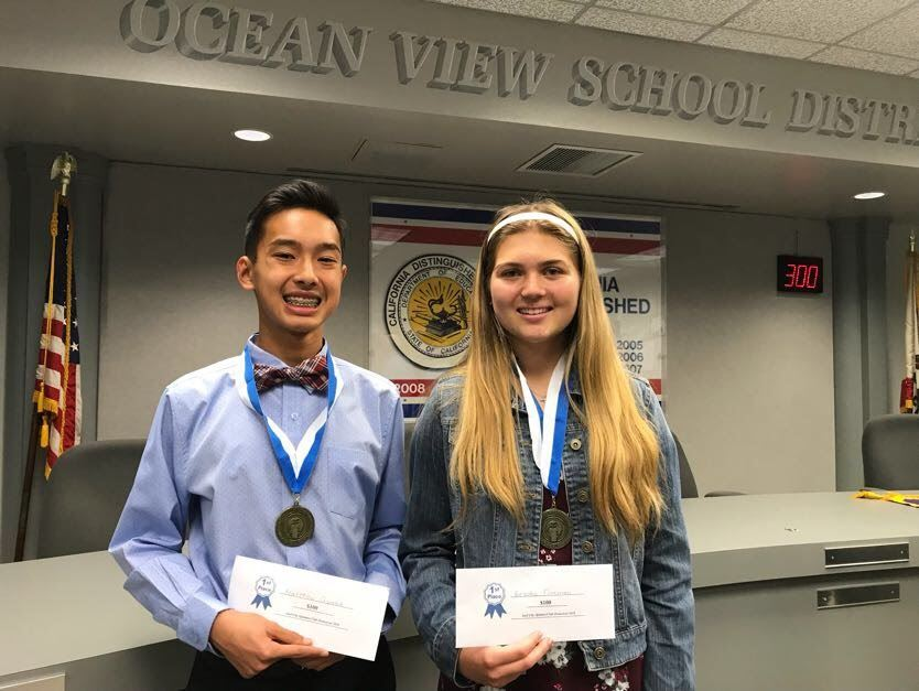 Oratorical Winning Students Hold Checks and Medals