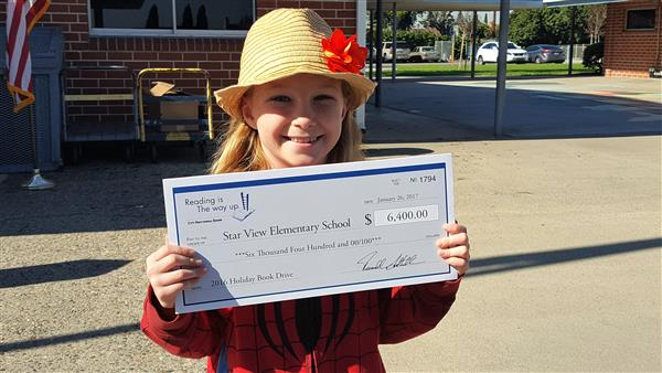 Star View Student with Donation Check