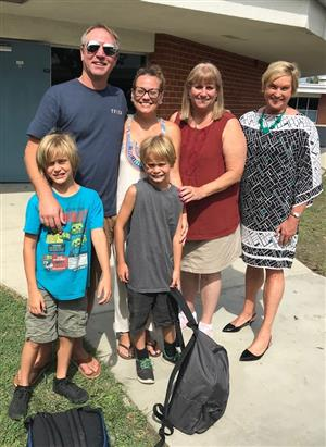 Westmont family with Principal Sue Broderson and Carol Hansen