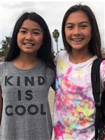 "Two girls wearing ""kind is cool"" shirt"