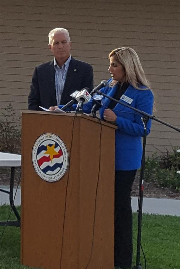 Board President Gina Clayton-Tarvin and Republic Services' Dave Hauser at a press conference